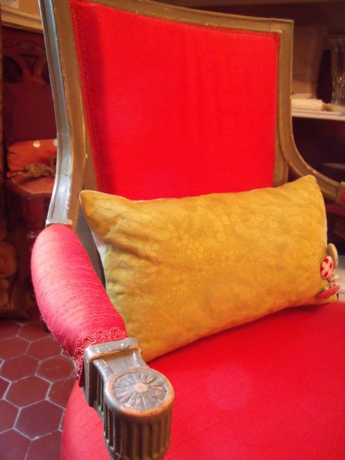 Coral silk armchair