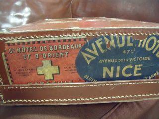 Suitcase with souvenir de voyage