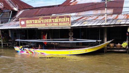 Long tail boat along the river