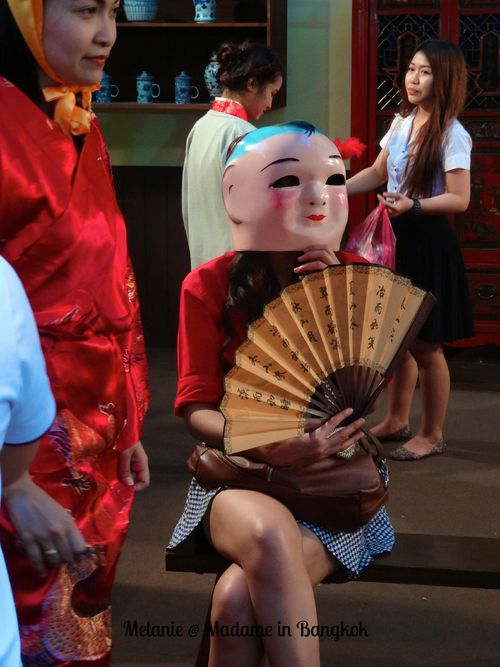 Girl with a mask in chinatown