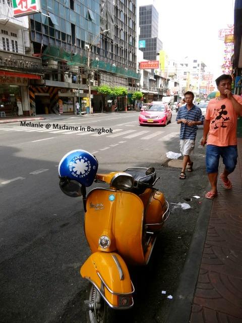 Orange vespa in Chinatown
