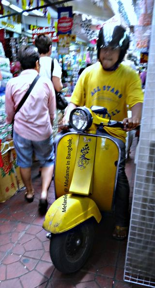 Yellow vespa in Chinatown sampeng lane