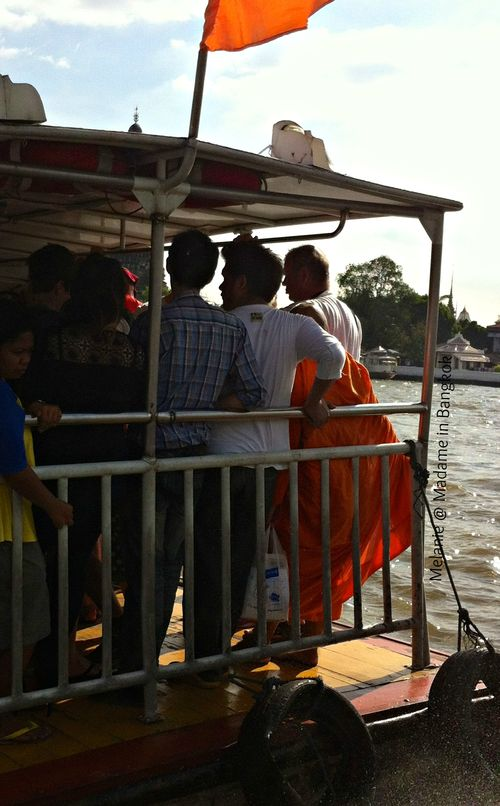 Monk on the chao phraya river