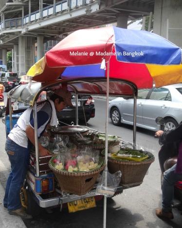 Streets of Bangkok fruits seller on Silom