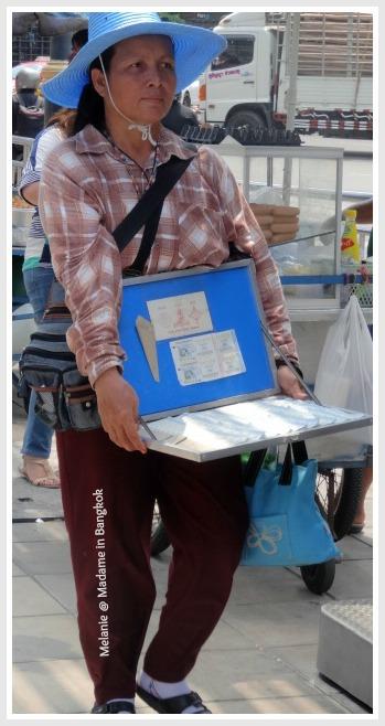 Streets of Bangkok lottery tickets seller on silom