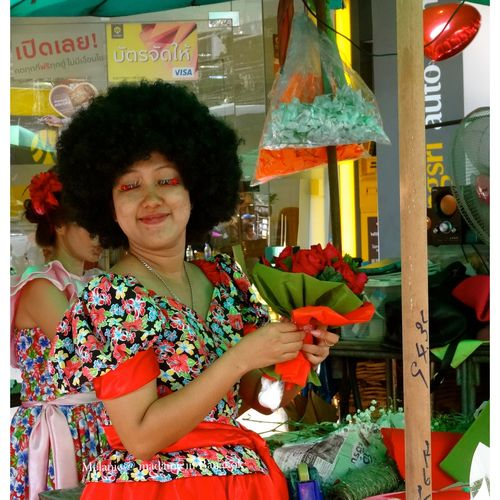 Seller in flowers market . Bangkok